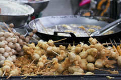 Skewered fried meat and balls on sticks, asian street food. And in phetchaboon thailand Royalty Free Stock Images