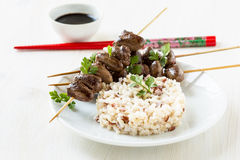 Skewered and grilled chicken hearts Stock Photos