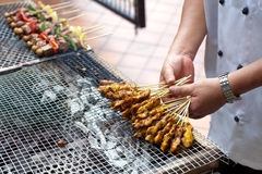 Skewered and Grilled Meat, Satay. Barbeque or Grilled skewered meat on a grill stove Royalty Free Stock Photos