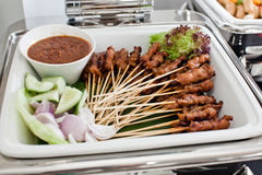 Skewered and Grilled Meat, Satay. Grilled skewered meat (satay) on a chaffing dish Royalty Free Stock Photography