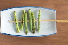 Skewered salt seasoned asparagus. Closeup of skewered salt seasoned asparagus Royalty Free Stock Photos