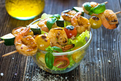 Skewered Tiger Prawns with fresh salad Royalty Free Stock Photos