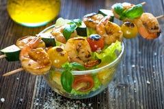 Skewered Tiger Prawns with fresh salad Royalty Free Stock Photos