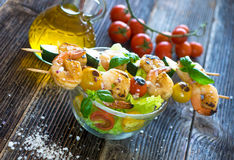 Skewered Tiger Prawns with fresh salad Stock Images