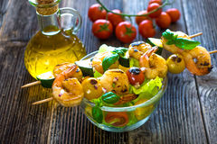 Skewered Tiger Prawns with fresh salad Stock Images
