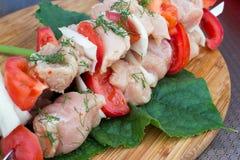 Skewered on wooden sticks tasty pork meat Stock Images
