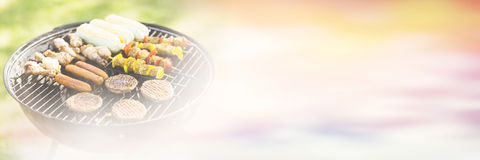 Skewers on barbecue grill in garden. On sunny day Stock Photo