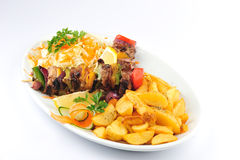 Skewers with cabbage salad and fries Stock Image
