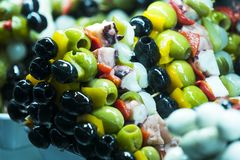 Skewers of cheese and seafood vegetables on the market of San Miguel Royalty Free Stock Image