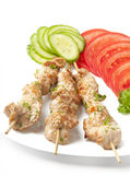 Skewers of chicken. On a plate Royalty Free Stock Photo