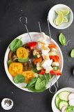 Skewers with chicken fillet, capsicum, zucchini, champignons and fresh colored tomatoes, spinach, cucumber, radish. Top. Skewers with chicken fillet, capsicum Stock Images