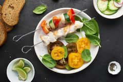 Skewers with chicken fillet, capsicum, zucchini, champignons and fresh colored tomatoes, spinach, cucumber, radish. Top. Skewers with chicken fillet, capsicum Stock Photo