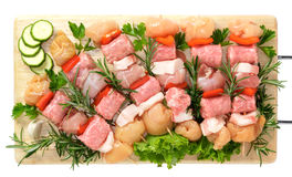 Skewers of chicken with pepper. On wooden board stock image