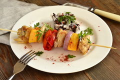 Skewers of chicken with vegetables Stock Images