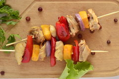 Skewers of chicken with vegetables Stock Photos