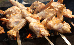 Skewers of chicken wings. Roasting on the grill Royalty Free Stock Images