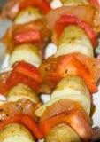 Skewers in detail. Meat skewers with potatoes and vegetable in detail Stock Image