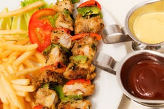 Skewers of fish. Skewers of fish with a glass of white wine - a nice dinner stock photos