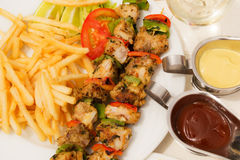 Skewers of fish. Skewers of fish with a glass of white wine - a nice dinner stock photo