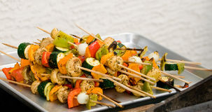 Skewers on the grill Stock Photos
