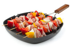 Skewers in grill pan. Meat and vegetables skewers in grill pan Stock Photography