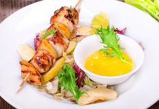 Skewers of grilled chicken with apples Royalty Free Stock Image