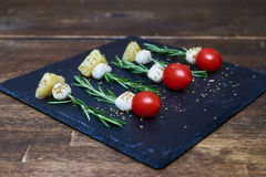 Skewers made of rosemary with cheese and tomatoes Stock Image