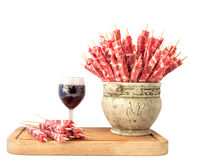 Skewers of meat and a glass of red wine stock photos