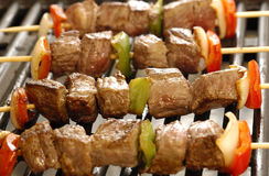 Skewers of meat on the grill Royalty Free Stock Image