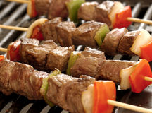 Skewers of meat on the grill Stock Photo