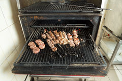 Skewers of meat on the grill Royalty Free Stock Photos