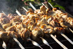 Skewers with a meat kebab on the grill Royalty Free Stock Photos