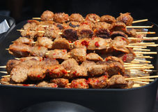 Skewers of meat selling  Stock Images