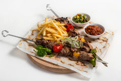 Skewers of Meat with sauce and potatoes fries on  white backgrou Stock Photo
