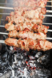 Skewers with meat shish kebabs over burning coal Royalty Free Stock Photography