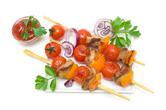 Skewers of meat with vegetables isolated on a white background Royalty Free Stock Images