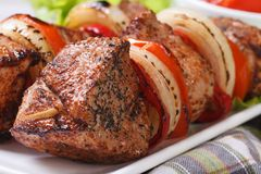 Skewers with meat and vegetables macro. Horizontal Stock Photography