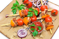 Skewers of meat with vegetables on a plate - white background Royalty Free Stock Photography