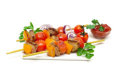 Skewers of meat with vegetables on a white background Royalty Free Stock Photos