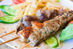 Skewers with mix arabic kebabs close up stock photo