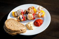 Skewers on a plate Royalty Free Stock Photos
