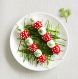 Skewers of quail eggs. And tomatoes Stock Images