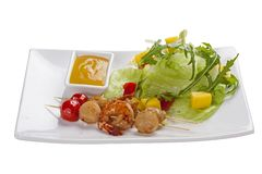 Skewers of scallops and shrimp. On a white plate stock photos