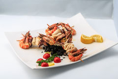 Skewers of seafood with black rice Royalty Free Stock Photo
