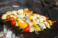 Skewers of seafood grilling Royalty Free Stock Photos