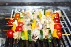 Skewers of seafood grilling Royalty Free Stock Images