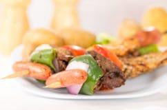 Skewers shish kebab sticks grilled meat chicken Stock Photo