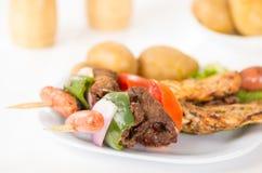 Skewers shish kebab sticks grilled meat chicken Royalty Free Stock Image