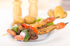 Skewers shish kebab sticks grilled meat chicken Stock Images