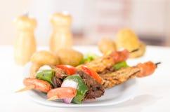 Skewers shish kebab sticks grilled meat chicken Royalty Free Stock Photo